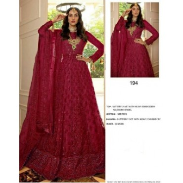 Butterfly net with heavy embroidery work and mirror work pakistani gown maroon