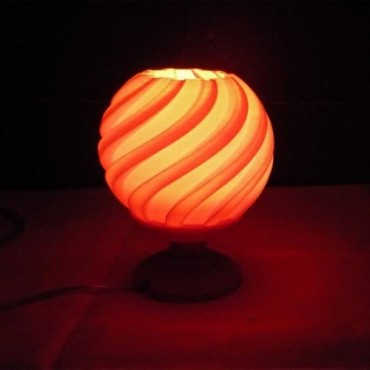 An hour glass inspired night lamp design a best gift article in any festivals.